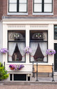 Traditional dutch windows with flowers Royalty Free Stock Photo