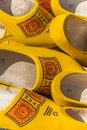 Traditional dutch wooden shoes in yellow and red Stock Photo