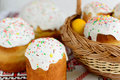 Traditional easter cake kulich Ukrainian style with colored eggs on painted towel