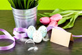 Traditional easter egg decoration with tulips and ribbo Stock Image
