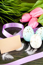 Traditional easter egg decoration with tulips and ribbo Stock Photos