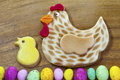 Traditional easter iced biscuits multicolour chocolate eggs border Stock Photos