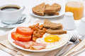 Traditional english breakfast with fried eggs bacon and beans horizontal Royalty Free Stock Photography