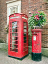 Traditional English, British red Phone box and post, letter box. Royalty Free Stock Photo