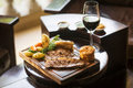 Traditional english food sunday roast lunch in restaurant cozy pub with glass of red wine Stock Photography