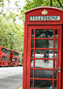 Traditional English Red Telephone Phone Box and Red Double Decker Buses London England Royalty Free Stock Photo
