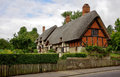 Traditional english thatched cottage in the countryside Stock Photo