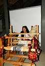 Traditional evening sitting with woman who spinning wool Royalty Free Stock Photo