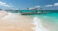 Traditional filipino asian ferry taxi tour boats on puka beach Royalty Free Stock Photo