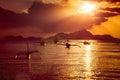 Traditional filippino boats at El Nido bay in sunset lights. Palawan island, Philippines Royalty Free Stock Photo