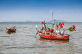 Traditional fishing boat anchoring near a beach Royalty Free Stock Photography
