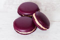 Traditional french macarons on white wood Royalty Free Stock Image