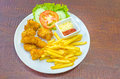 Traditional French potato fries with tomato salad ketchup and ma Royalty Free Stock Photo