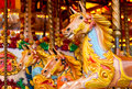 Traditional funfair carousel amusement ride found at old fashioned fairgrounds Royalty Free Stock Images