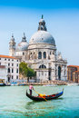 Traditional Gondola on Canal Grande with Basilica di Santa Maria, Venice, Italy Royalty Free Stock Photo