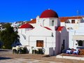 Traditional greece church with cafe tables on the island of mykonos Royalty Free Stock Images