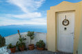Traditional greek door in santorini with a great view from island greece Royalty Free Stock Photo