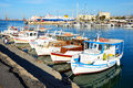 The traditional greek fishing boats heraklion greece may are near pier and tourists on may in heraklion greece up to mln tourists Royalty Free Stock Photo