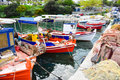 Traditional Greek fishing harbour with boats white houses Royalty Free Stock Photo