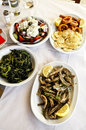 Traditional greek food in a tavern Stock Images
