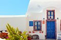 Traditional Greek house with blue door and windows, Santorini Royalty Free Stock Photo
