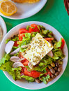Traditional greek salad a plate with with fresh vegetables feta cheese and olives Stock Images
