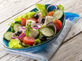 Traditional greek salad white wood background Stock Photo