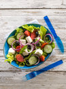 Traditional greek salad white wood background Stock Images