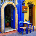 Traditional greek streets with small tavernas Stock Photos