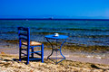 Traditional greek table at the beach in greece Royalty Free Stock Images