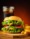 Traditional hamburger french fries and cola drink still life with potatoes Stock Photos