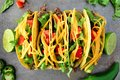 Traditional hard shelled tacos, overhead view on rustic tray Royalty Free Stock Photo