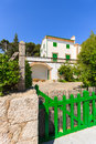 Traditional holiday villa on majorca island and green fence gate in port pollenca town spain Royalty Free Stock Photo