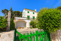 Traditional holiday villa on majorca island and green fence gate in port pollenca town spain Stock Images