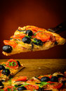 Traditional homemade pizza italian with tomatoes olives and mushrooms Royalty Free Stock Images