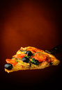 Traditional homemade pizza italian with tomatoes olives and mushrooms Stock Photos