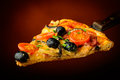Traditional homemade pizza italian with tomatoes olives and mushrooms Royalty Free Stock Photography