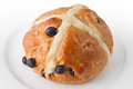 Traditional hot cross bun white plate Royalty Free Stock Image
