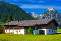 Traditional house on alps mountains background Royalty Free Stock Image