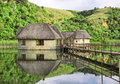 Traditional house on lake shot in monks cowl area drakensberg mountains south africa Royalty Free Stock Image