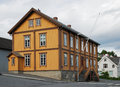 Traditional house in the modern street of Tromso. Royalty Free Stock Photo
