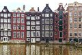 Traditional houses of amsterdam dutch scenery with canal and canalside Royalty Free Stock Photo
