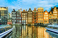 Traditional houses of amsterdam netherlands with boats and reflections in the water Stock Photo