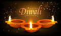 Traditional illuminated lit lamps for happy diwali beautiful oil on shiny brown background indian festival of lights celebration Stock Photography
