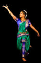 Traditional indian dance expression young woman in sari dancing classical bharatanatyam on a black background Stock Image