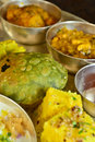 Traditional indian vegeterian food platter consisting of different curries puri and sweet Stock Photography