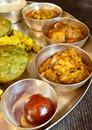 Traditional indian vegeterian platter consisting of different curries puri and sweet Stock Photography