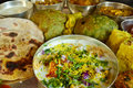 Traditional indian vegeterian platter consisting of different curries puri and sweet Stock Images