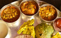 Traditional indian vegeterian platter consisting of different curries puri and sweet Royalty Free Stock Photography