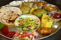 Traditional indian vegeterian platter consisting of different curries roti and sweet Royalty Free Stock Photos